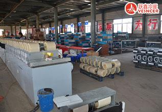 卧式暗装风机盘管组装车间_表冷器整齐堆放
